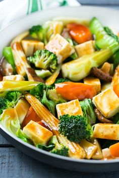 This recipe for Buddha's Delight is a classic Asian dish full of mixed vegetables and tofu in a savory sauce. Male you own take out in less than 30 minutes! #soyfoodsmonth #ad