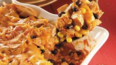 Enjoy this cheesy casserole made using chicken, tortillas, black beans, Green Giant® Niblets® Frozen Corn and Old El Paso® Enchilada Sauce. Mexican dinner ready in just an hour!