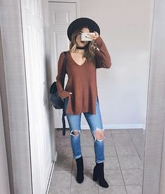 Ribbed sweater w/side slits, ripped jeans, black ankle boots, choker, black hat
