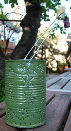 Maybe colored tin can luminaries for a candle option? This might also be less wedding like.still rustic. Tin Can Art, Tin Art, Tin Can Crafts, Diy And Crafts, Arts And Crafts, Punched Tin Patterns, Recycle Cans, Repurpose, Reuse