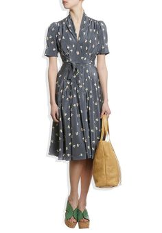 love the knee-length cocktail dress by Orla Kiely with the green heels!
