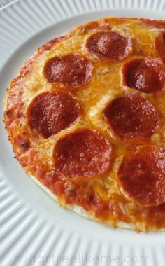 Easy Low Carb Tortilla Pizza ~ Ingredients: Low carb tortillas (I use Mission Brand Carb Balance, but many people use Mama Lupe's), Pizza sauce (Always check labels, but most store bought pizza sauce is low carb) & your toppings Cheese, pepperoni (or just whatever pizza fixings you like).