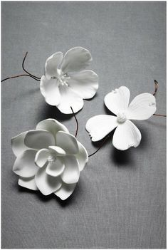 Delicate porcelain blooms from BHLDN can decorate anything from the table to your hair to dessert. $10 each