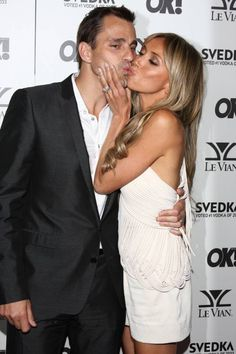 Guiliana and Bill... amazing couple!  http://cdn.blogs.sheknows.com/celebritypregnancy.sheknows.com/2010/09/Bill_Giuliana_Rancic_OK_Magazine_5th_Anniversary_party.jpg