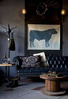 This tufted leather sofa would be great in a den or library.  Dark sofa in a darkroom. Perfect!
