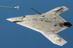 The unmanned X-47B air refueling from a tanker.