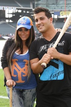 Gym, tan swing! Snooki and her fiance Jionni LaValle step up to the plate at the Citi Field in New York City