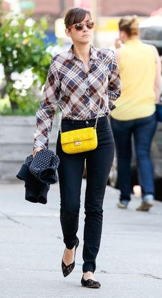 Marion Cotillard packs a punch with a bright yellow bag