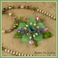 I really like this pendant layered with Czech glass leaves and flowers.  Absolutely beautiful! Flower Necklace | Flickr - Photo Sharing! www.flickr.com/photos/beaded_art/43821312178