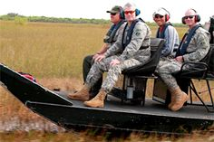 After visiting the Tamiami Trail bridge site, Maj. Gen. Michael J. Walsh, Deputy Commanding General for Civil and Emergency Operations for the U.S. Army Corps of Engineers, took an airboat ride through the Everglades alongside Dan Kimball  (left), superintendant of Everglades National Park, Col. Alan Dodd, Jacksonville District commander (right), and Howie Gonzales, chief of the Jacksonville District's Ecosystem Branch Jan. 23, 2013.