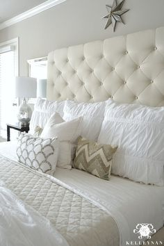 - Kelley Nan: Master Bedroom Update- Calming White and neutral master bedroom with tufted ottoman stools, Pottery Barn Tall Lorraine Headboard, Diamond linen quilt and hadley ruched duvetKelley Nan: Master Bedroom Update