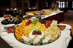 An exquisite display of our platters. We offer a wide range of imported cheeses, fresh fruit, delicious desserts, and delectable seafood.