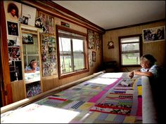 MARY LEE BENDOLPH, born 1935, quilting in her home.