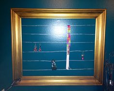 Old picture frame turned into a jewelry holder.