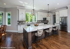 Open concept kitchen from The Butler Ridge home plan 1320-D. #WeDesignDreams