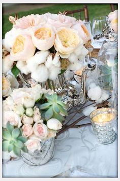 Vintage-teapots-with-flowers-and-succulents-for-the-rustic-looking-centerpieces.jpg 513×771 pixels