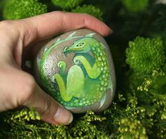 Stone with a hand-painted sleeping dragon by SkadiaArt on Etsy