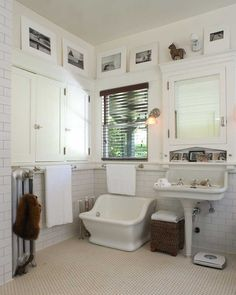The master bath boasts original fixtures and fittings—a single-leg porcelain pedestal sink and a sitz bath (good for washing the dog).
