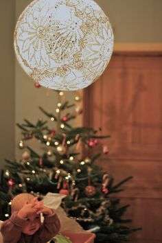 the doily lamp idea has been floating around for a while but I like the christmas context.