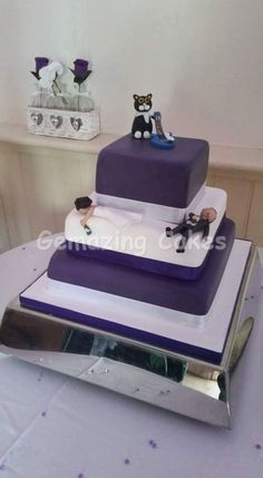 Purple and White Wedding Cake Bottom tier - Chocolate cake, chocolate buttercream and hazelnut spread Middle and top tier - Vanilla cake, vanilla buttercream and strawberry jam I made cat and guitar figurines but not the people.