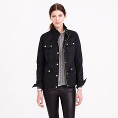"""Field jacket in black. """"In water-resistant waxed cotton with military-inspired pockets and snaps, this is our idea of standard issue."""" - J. Crew."""