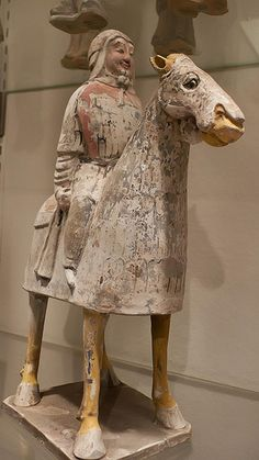550-577 CE Armored Horse and Rider made for a tomb Northern Qi Dynasty China. Painted Earthenware.