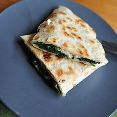 "Spinach Quesadilla  Fresh baby spinach is the ""meat"" of this low calorie quesadilla. Sauté a large handful of spinach with a teaspoon of olive oil until wilted (about 3 minutes), then add 3 egg whites, and a tablespoon of feta cheese. Quickly fold the mixture together and transfer to a whole-wheat tortilla. Fold the quesadilla in half and lightly toast both sides in the skillet. 289 calories"