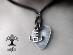 https://www.etsy.com/listing/481307851/mens-guitar-pick-and-hammer-necklace?ref=shop_home_active_1