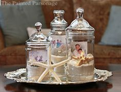 Sand, sea shells, and beach photos in apothecary jars by The Painted Parsonage