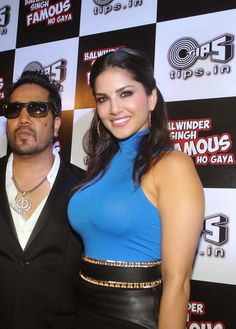 Sunny Leone Showcasing Her Sexy Curves In a Figure Hugging Dress At 'Balwinder Singh Famous Ho Gaya' Music Launch In Novotel, Mumbai