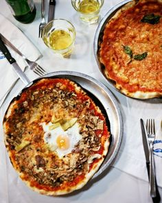 Pizza achieves apotheosis at the table—at Baffetto in Rome, for instance, where you can tuck into a classic Margherita (top) or a pizza with sausage, mushrooms, artichoke hearts, and an egg on top.