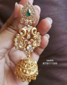 Pure silver kudhan jewellery with gold polish . Earrings with peacock design. Earrings studded with multi color CZs.whats app 20 September 2018 Gold Jhumka Earrings, Gold Earrings Designs, Gold Jewellery Design, Jewellery Earrings, Jewellery Shops, Jewelry Stores, Earings Gold, Jewelry Rings, Jhumka Designs