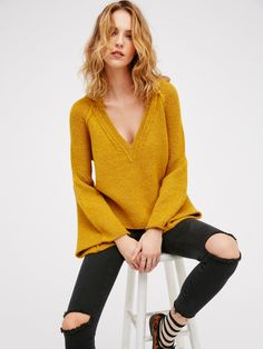 Lovely Lines Pullover | Lovely pullover sweater with a plunging V-neckline and dramatic flared sleeves. Super soft and stretchy fabrication creates an ultra comfy fit.