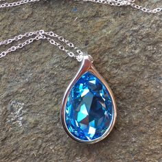 Handcrafted necklace made with Swarovski crystal HP 2/9/2016!!!  💖💖💖This necklace is made with a genuine aquamarine Swarovski crystal in a beautiful pear shaped  silver-toned pendant. This is so eye-catching. 2nd picture for approximate sizing.  Hubby & I make our jewelry using genuine Swarovski crystals.  All items are brand-new and much prettier in person than pictures.  Proceeds used to help our 5-yr-old granddaughter Lila May in her fight against cancer, but she lost her battle…