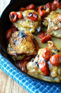 Chicken thighs roasted in a blistered tomato and wine sauce. This chicken thigh recipe uses just a handful of easy ingredients and only one pan! Delicious dinner!