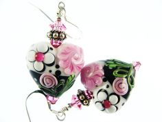 These awesome floral heart earrings features artisan lampwork 19mm beads with white flower and pink roses. The base of the beads are black and white with black and white dots. The beads are topped off with swarovski crystals and sterling silver findings.  The earrings are 2 inches (5.0 cm) long measured from the extreme top of ear wire to the bottom of of the beads.  Thanks for visiting Jadjus Jewelry