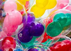 """""""This makes me think of my honeymoon! As a wedding present my husband gave me a certain amount of money to give away... I loved buying these balloons, and giving them to little kids!"""" I REALLY like that idea.... :D"""