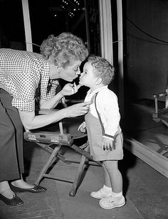 """Lucille Ball and Desi Arnaz Jr.  In 1962, Ball became the first woman to run a major television studio, Desilu, which produced many successful and popular television series such as """"Mission Impossible"""" and """"Star Trek"""""""