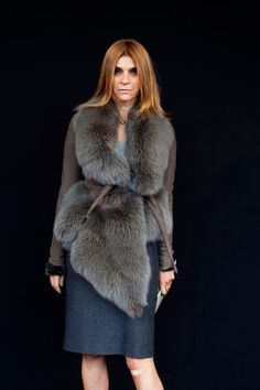 Don't love fur, but I love this. I love her. The editor of Vogue Italia. I think it's a prerequisite that the most stylish women never smile.