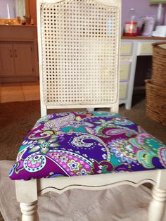 Took an old plain white cane chair with a white seat and repurposed it for the new room. Used Annie Sloan dark wax to antique the chair and a Vera Bradley napkin in the Heather print to recover the seat cushion. Coming together.