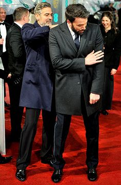 Events. George Clooney heled Ben Affleck brush off his coat outside the BAFTAs in London Feb. 10.