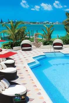 Cozy daybeds surround the tranquil pool at Sandals Royal Bahamian Vacations To Go, Caribbean Vacations, Vacation Destinations, Vacation Trips, Dream Vacations, Vacation Spots, Royal Bahamian, Romantic Beach Getaways, Places To Travel