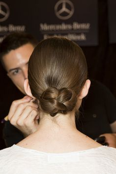 A chic braided chignon spotted at Tadashi Shoji's Spring 2015 #NYWF show.