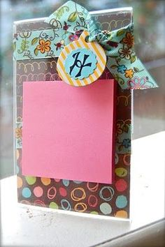 Cute Cute Cute and inexpensive teacher gifts! Post it station with a nice twist! Clear picture frames, scrapbook paper, ribbon and post its! yay! super cheap and tooooo cute!