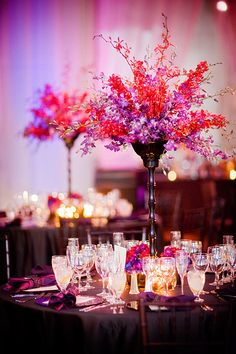 purple and red centerpiece by: Southern Blooms