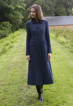 Elegant long coat in navy #HarrisTweed with velvet trim and a contrast red lining #HarrisTweed #LongCoat #GlenalmondTweed