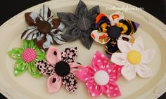 Fabric Flowers. I have already made some rolled fabric flower headbands, and I cannot wait to try these flowers!