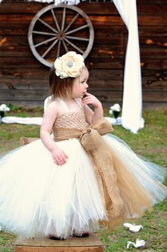 Rustic Dream-Ivory flower girl tutu dress with removeable satin singed flower and burlap sash/bow perfect for Rustic/Country Weddings. $60.00, via Etsy.