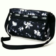 29 (SALE) NWT Lesportsac Small Shoulder Bag N-W-T Never been used before.   Add flavor to your carry-all collections with this pretty bag boasting a classic motif.  Pockets keep essentials organized, while an adjustable strap promises hands-free convenience. Top zip closure, lined.  Three exterior zip pockets. Polyester. Hand wash.   9.25'' x 7''  19'' max. strap drop LeSportsac Bags Crossbody Bags