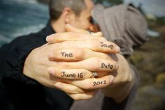 Save the date photo idea except put hands in a heart shape and write around it